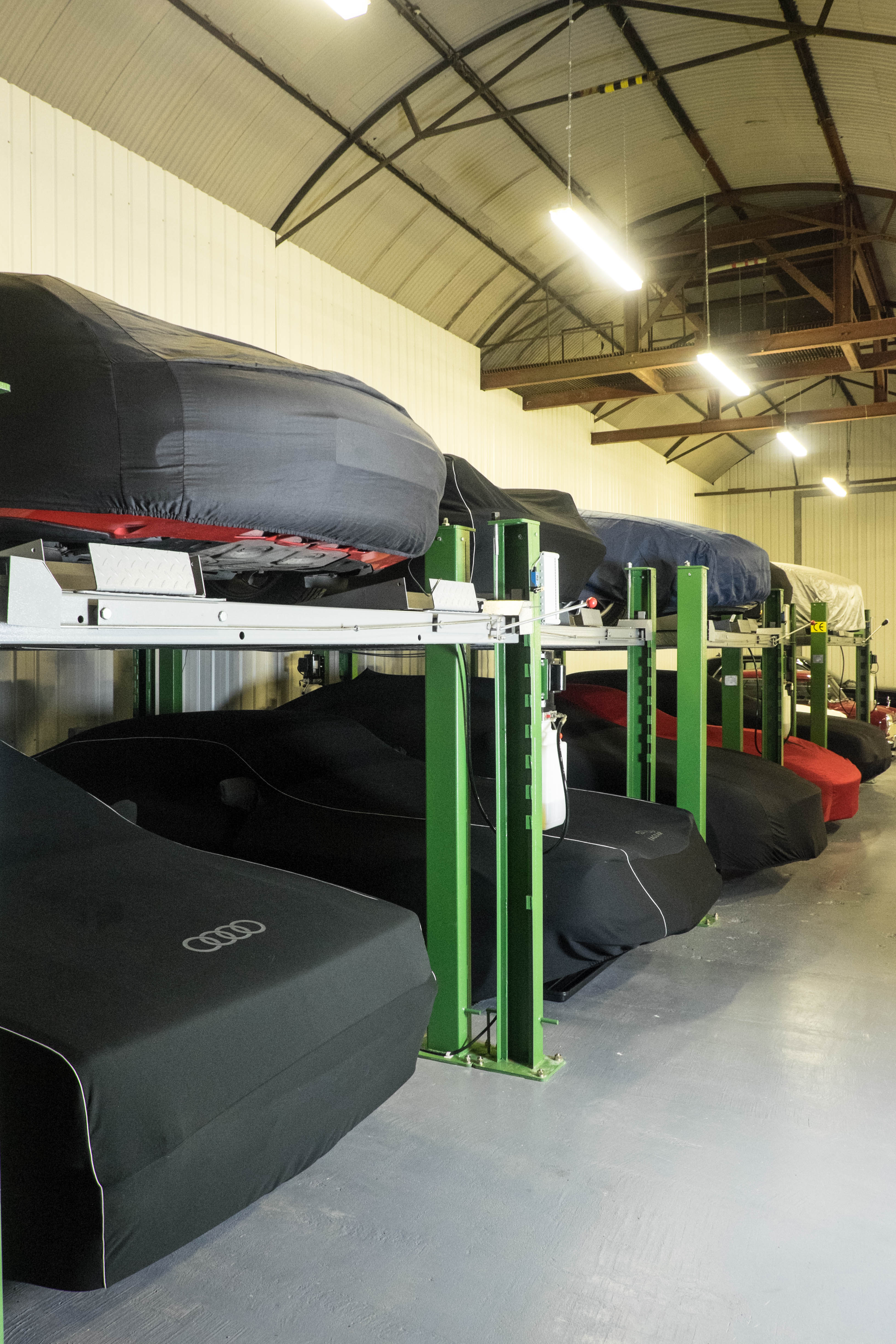 covered cars in tms car storage secure racking